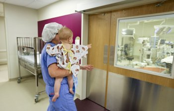 Nurse shows Pierson the OR before they enter.
