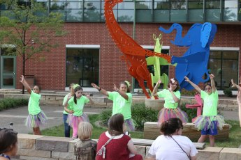 Attendees of the event enjoy a performance by Dance Unlimited