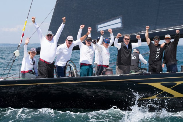 Challenge XII (KA-10) owner/helmsman Jack LeFort (second from left) celebrates victory and a World Championship title after today's final race of the 2019 12 Metre World Championship. (Photo Credit: Ian Roman)