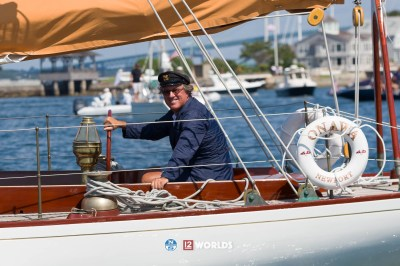 Earl McMillen at the helm during the Parade of Sail at the 2019 12mR World Championship
