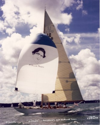 Earl McMillen's smiling face graced Onawa (US-6's) spinnaker while sailing at the America's Cup Jubilee, Cowes England, 2001; Earl stands below on the foredeck.