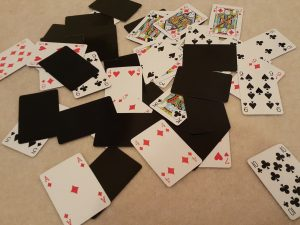 Playing_cards_spread_on_floor