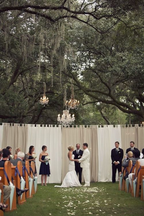 curtains and chandeliers in trees weddingfor1000.com