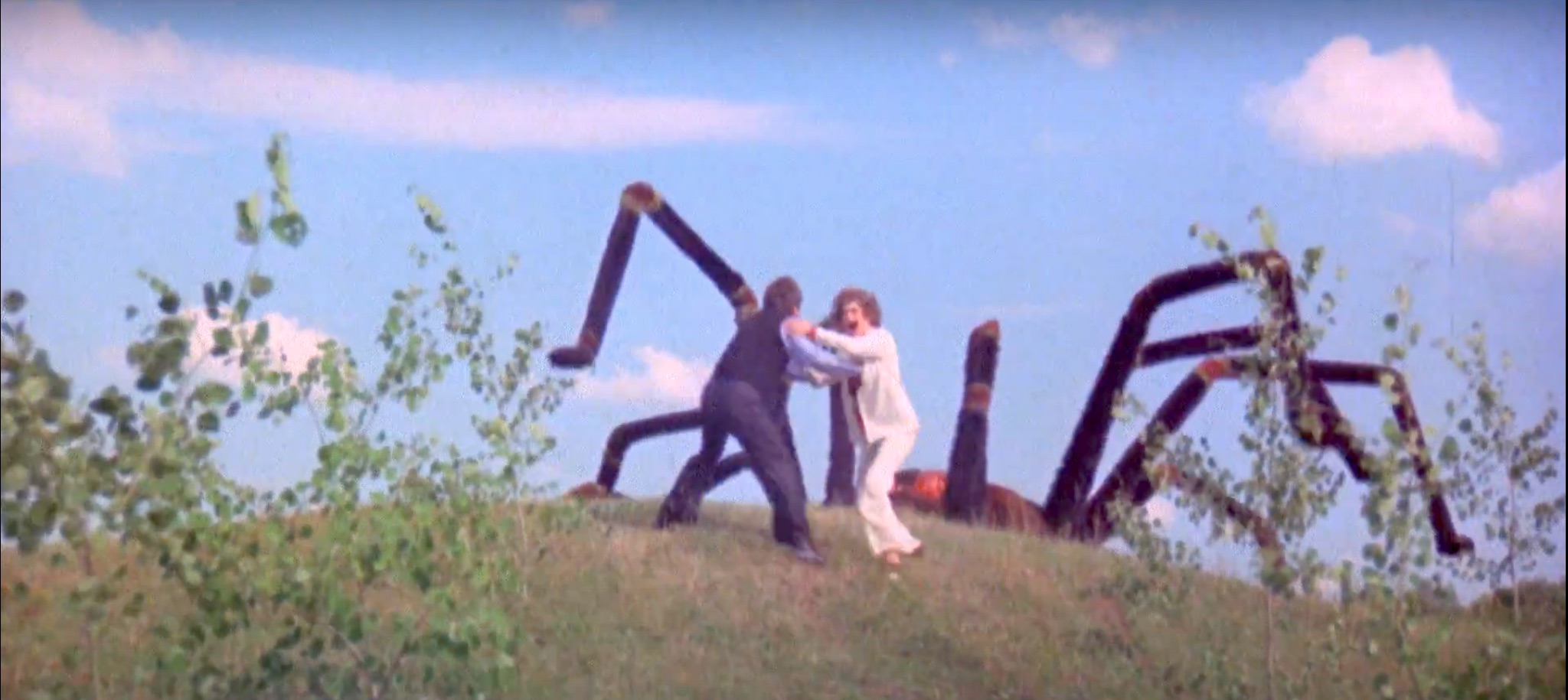 Giant spider coming over the hill, to eat our two scientists.