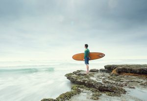Picture of Surfer on Cliff for Mindfulness Revolution program at 1440