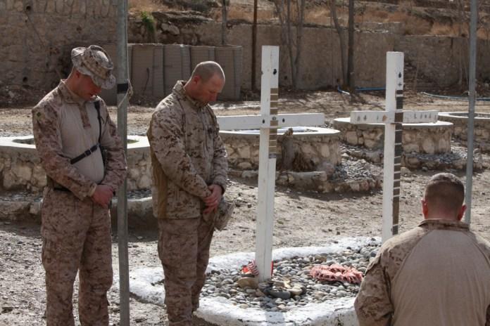 U.S. Marines mourn the deaths of U.S. troops in Kajaki, Afghanistan.