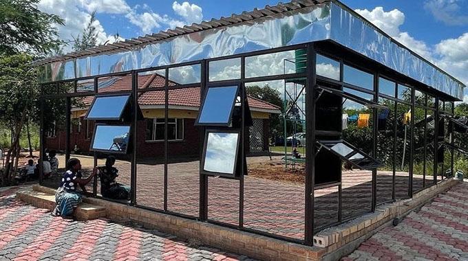 """The glass """"mausoleum"""" in which Kudzanai Kangara is buried in"""