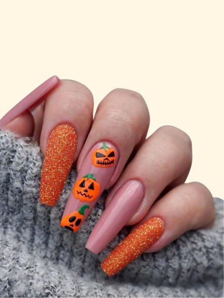 Orange glitter pumpkin Halloween nails in coffin shape