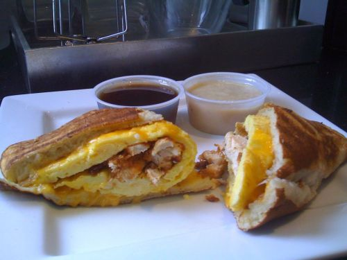 Triple Breakfast Panini Giant buttermilk pancake stuffed with fried chicken, eggs and cheddar cheese, pressed in a panini press and served with maple syrup and white gravy. (Submitted by Brett McMillin)
