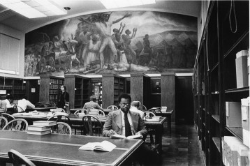 """Students in the Law Library with the mural, """"Freeing of the Slaves""""."""