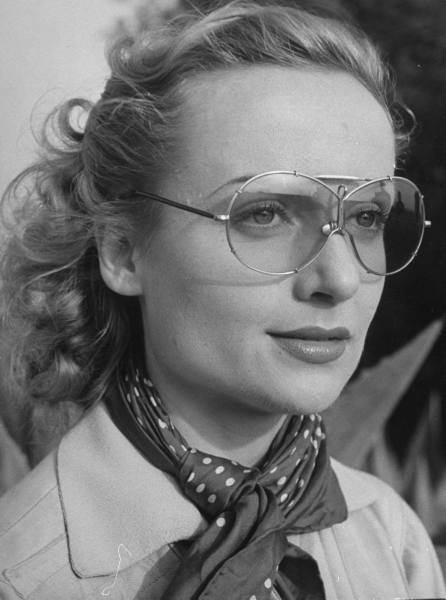 starsofyesterday: Carole Lombard wearing glassesfor a skeet shooting at a gun club.