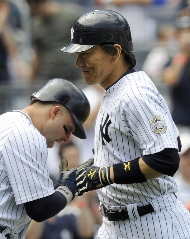 Swisher congratulates Hideki after a two run home run.