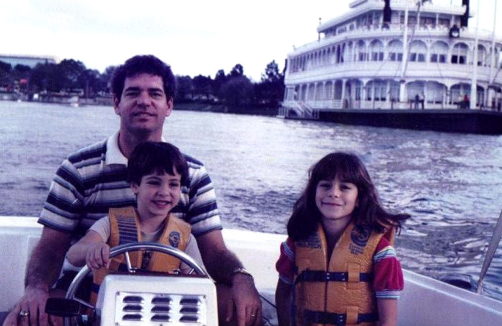 That's little Mark Teixeira driving a boat with his dad and his sister.