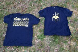 CHAIR branded T-Shirts on display