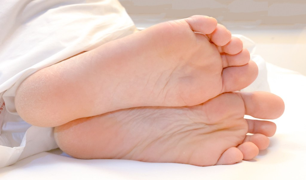 bare feet while sleeping in bed