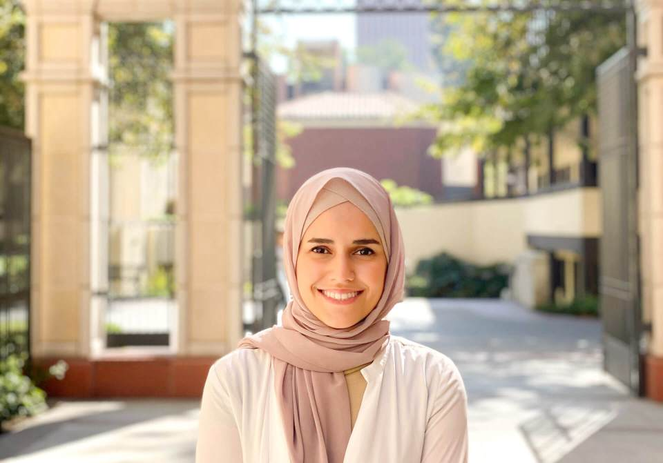 MIT recognized innovator Ghena Alhanaee under 35 photographed outside by the USC Cinema School gates.