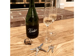 photos of champagne bottle, two glasses, and two sets of keys