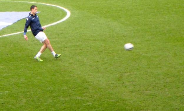 Fahey back kicking a ball