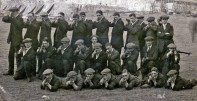 Frank Dunn - L/H Kneeling and men from C Company at Heaton Park. The Original tents and frames of the new huts can be seen under construction. Post marked 16th October 1914.