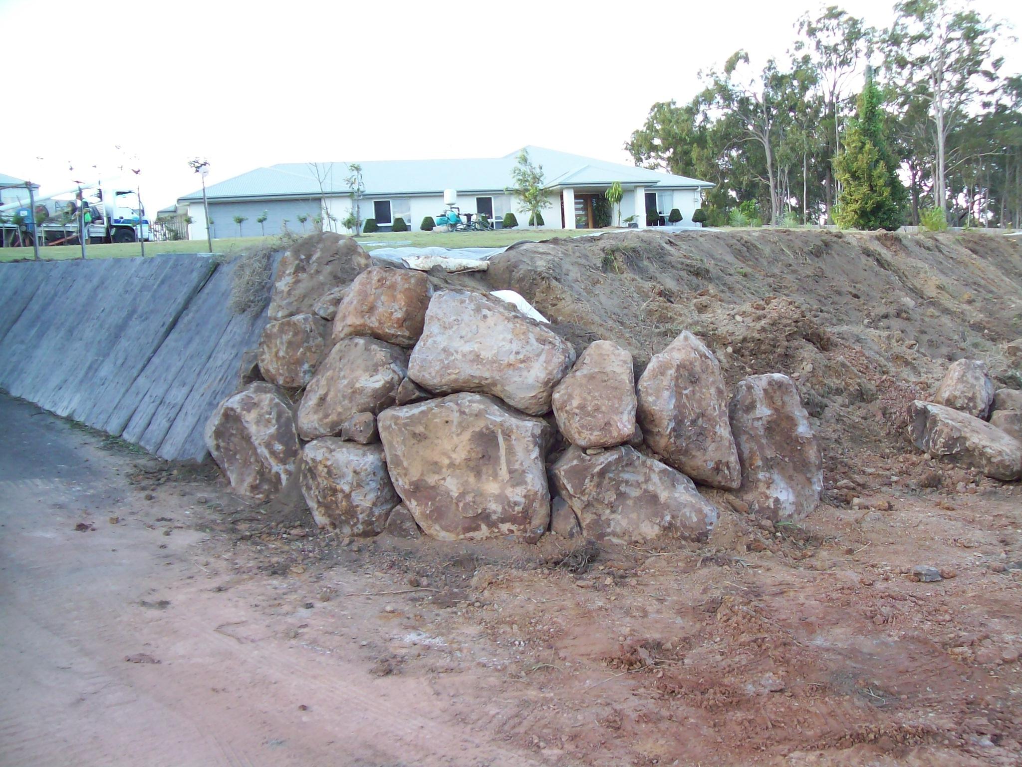 Boulder rock wall by Lifestyle Landscaping Bundaberg