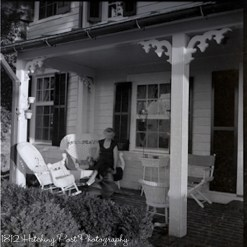 Mimi Henkel and dogs on side porch in the 1960's