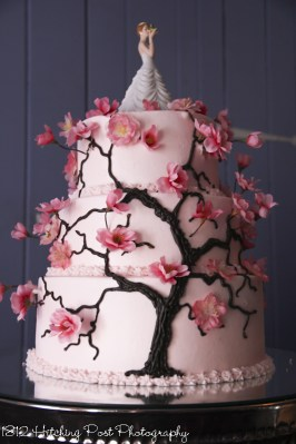Pink wedding cake with cherry blossoms