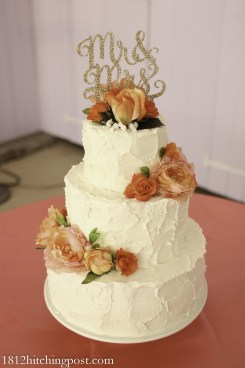 Gorgeous peach, coral, and gold wedding cake