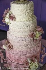 Ombre ruffles on feminine pink wedding cake