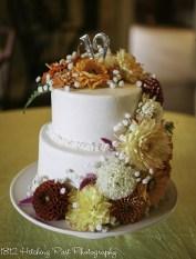 Lush fall flowers on cake