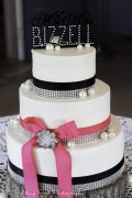 Hot pink and navy wedding cake with diamonds and pearls