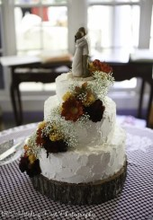 Cascade of fall colors on rough iced wedding cake