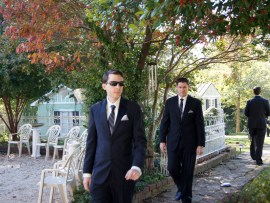 Groomsmen walking from dressing area to main house