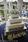 Pale blue ribbon on square cake