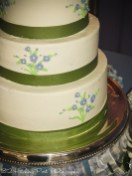 Delicate flowers on green and blue wedding cake