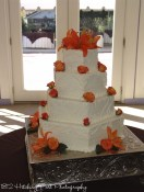 Hex shape wedding cake with orange flowers