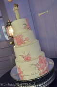 Pink flowers on wedding cake