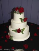 Red roses on cake