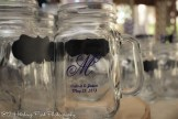 Mason jars with chalkboards for guests to write their names