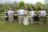 Wedding party by fence
