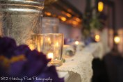 Flowers, doilies, mason jars, and candles on mantle