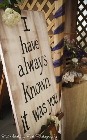 Bride provided sign next to party favor table