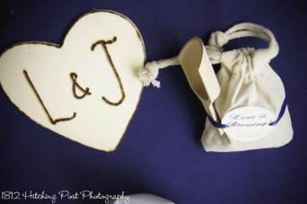 Wood burned heart as drink coaster with party favor on head table