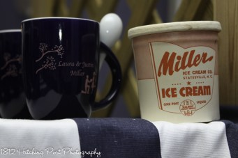 Personalized ice cream cups on blue/white fabric for ice cream bar with historic ice cream container