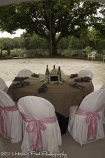 Rustic table set up with navy, burlap, and pink