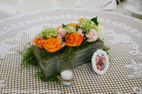 Peach, pink, cream, and green flowers on burlap and lace
