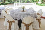 Lace over navy qwith burlap on chair covers