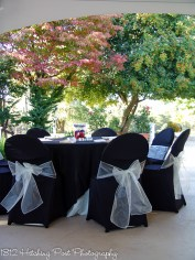 Black chair covers with white chair sashes