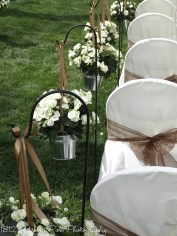 White begonias tied with chocolate ribbons