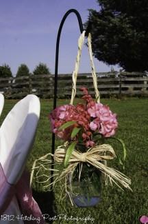 Pink hydrangeas in silk hanging from shepherd's hooks