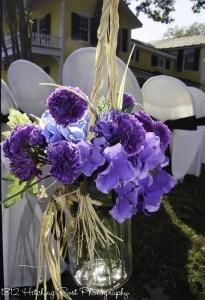 Silk blue and purple flowers in mason jar